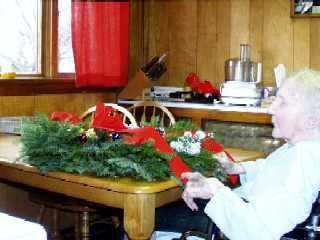 Mom working on her Christmas wreath